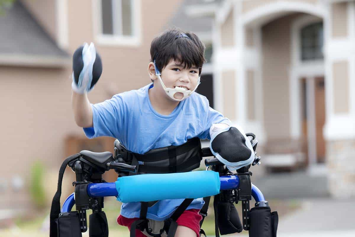 Disabled boy using mobility walker