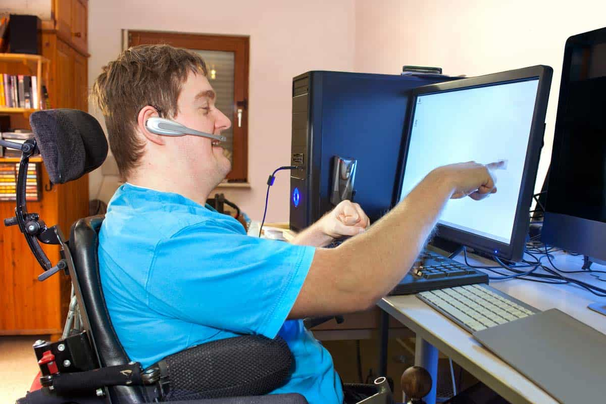 Man with cerebral palsy performing research