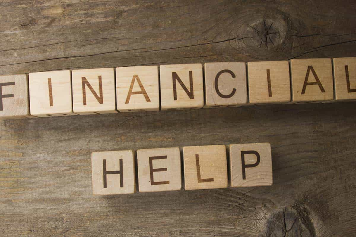 Wooden financial help sign