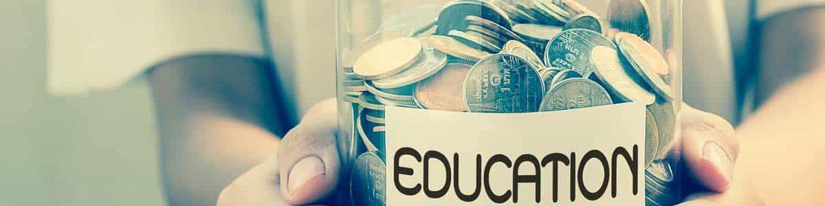 Child holding jar of money