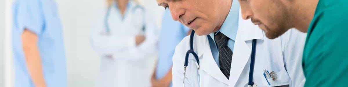 Doctors discussing paperwork