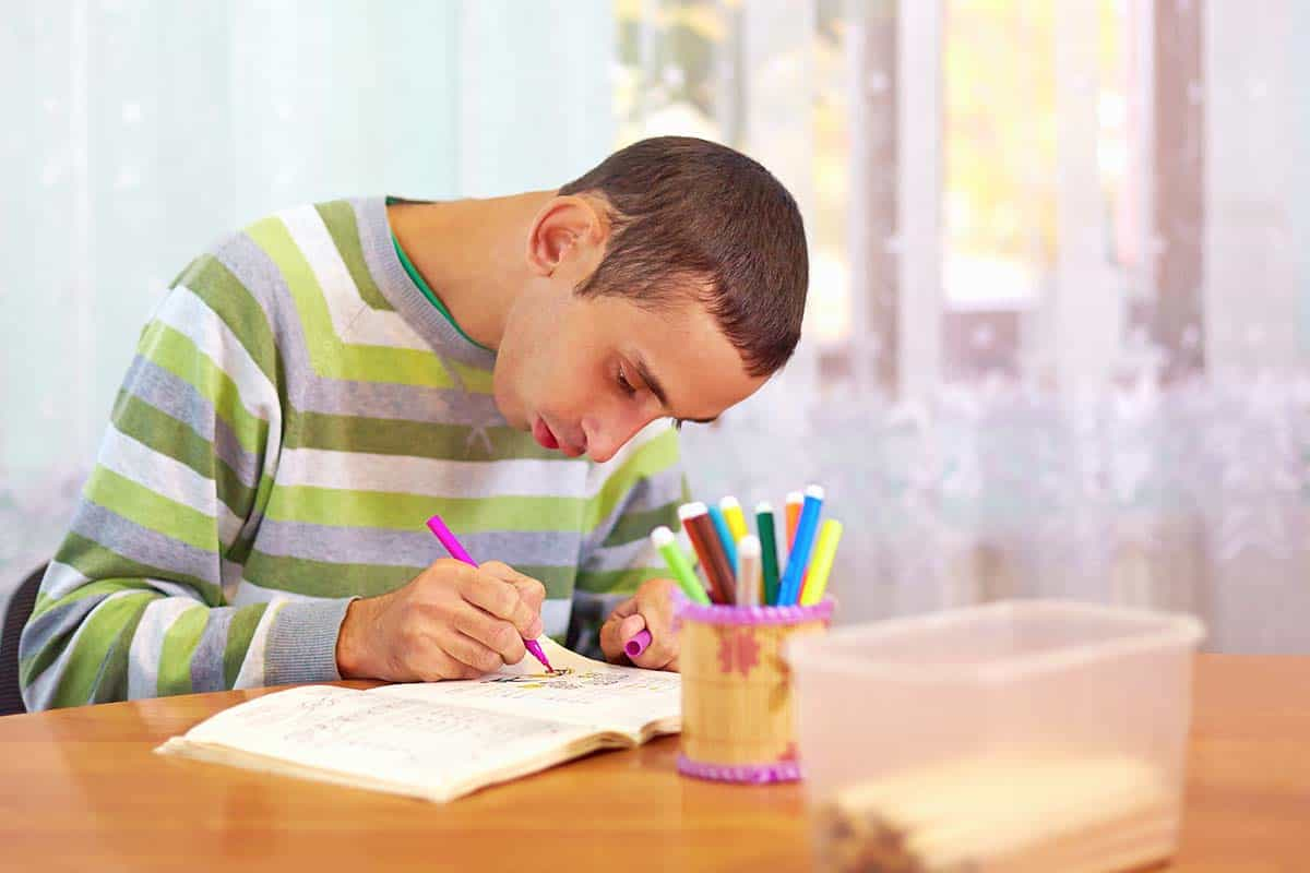 young adult man engages in self study