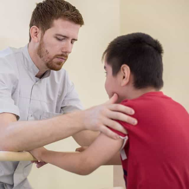 Doctor assisting boy