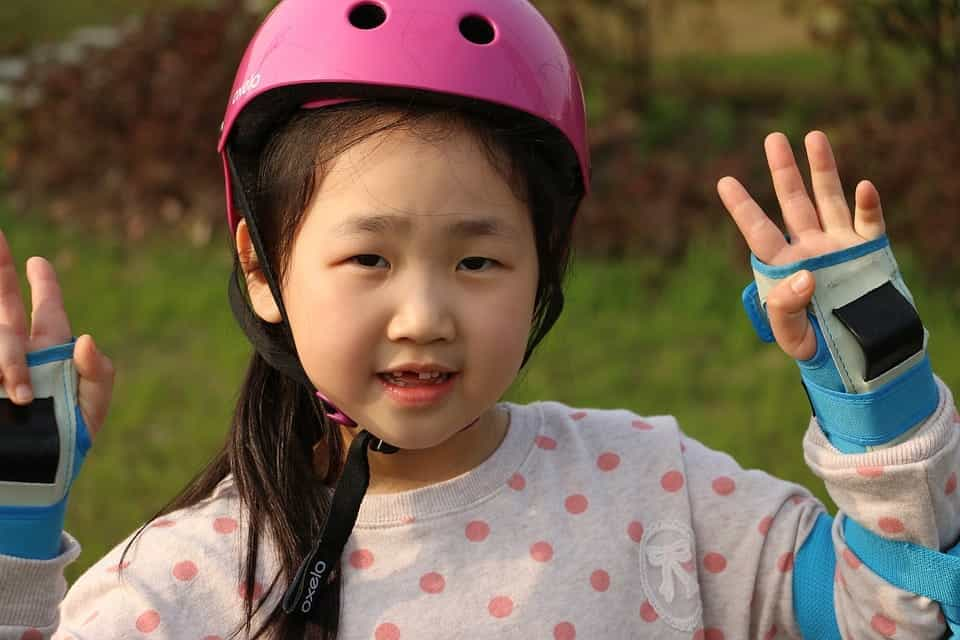 Girl with pink helmet