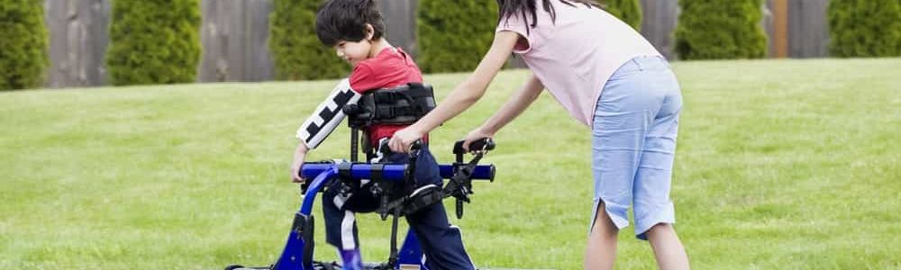 sister helping brother with walker