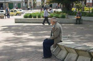 man sitting on bench alone