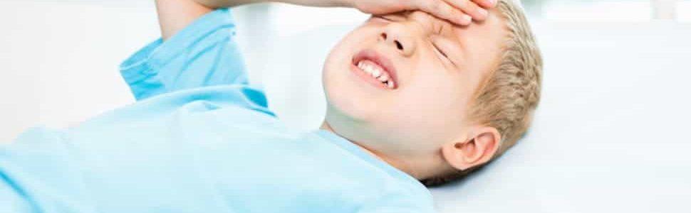 boy holding head in pain