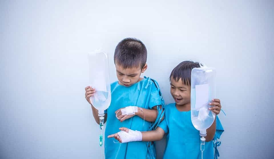two boys with IV packs