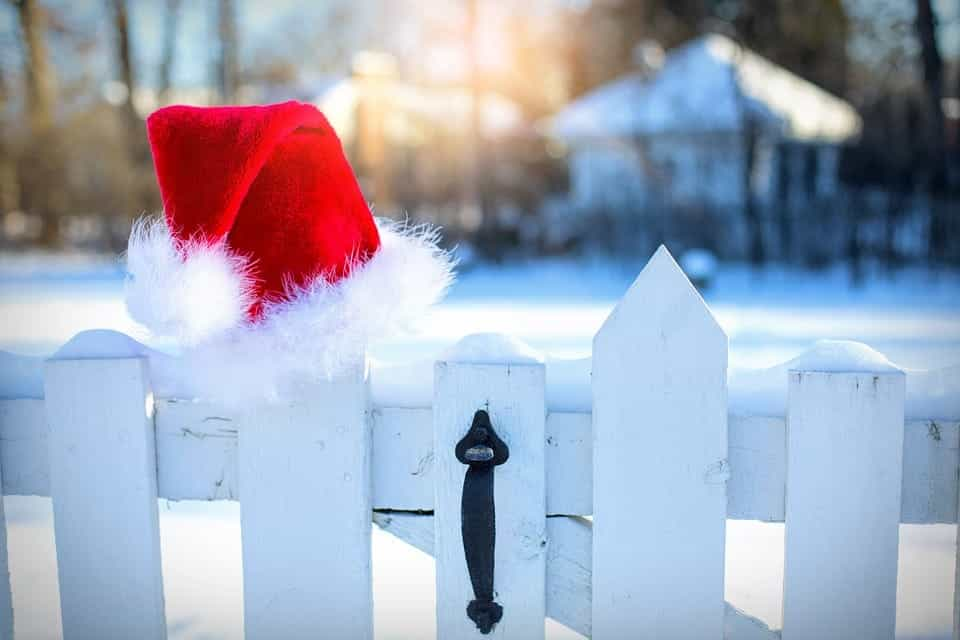Santa hat hanging on fence
