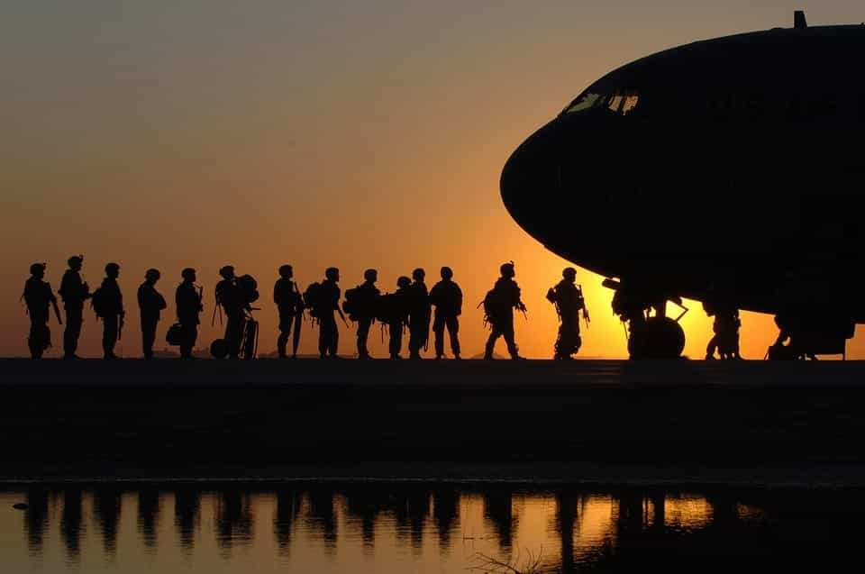 soldiers standing by plane