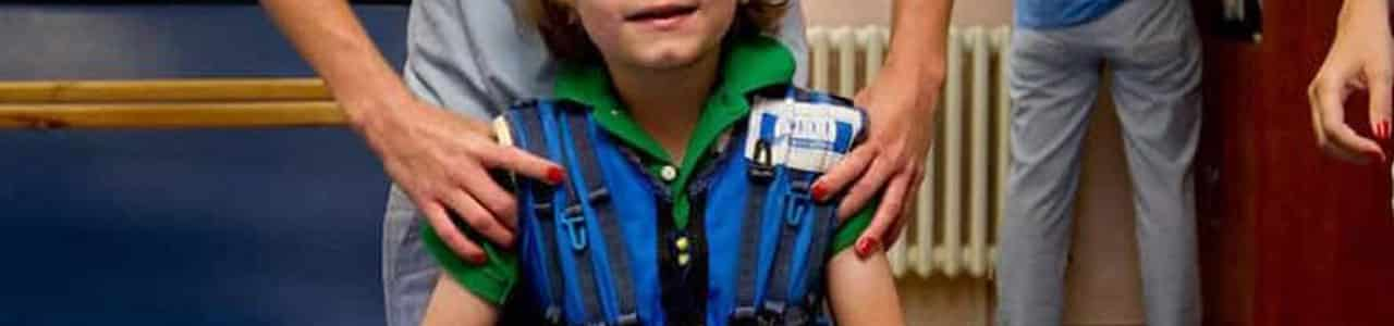 child wearing intensive suit
